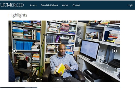 A photo of a UC Merced faculty member in his book-filled office graces the landing page of the UC Merced Image Library.